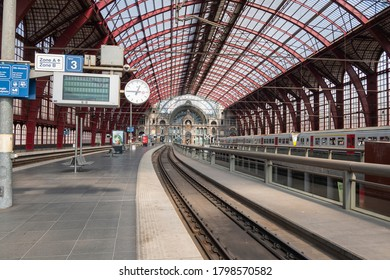 Antwerp, Belgium, 16 August 2020, Inside of the central station with tracks, platform and train
