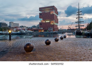 "Antwerp, Belgium - 18 September 2016: View on the MAS Museum and sailing boat in the area of Antwerp known as ""Eilandje""."