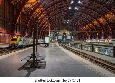 Antwerp, Belgium - 25 12 2019: symmetric interior of impressive, fascinating, world famous,  eclectic architecture style, amazing metal construction, huge central train station, in Antwerp