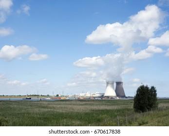 antwerp, belgium, 26 june 2017: ineos chemical factory along river Schelde in belgian city of antwerp under blue sky with clouds