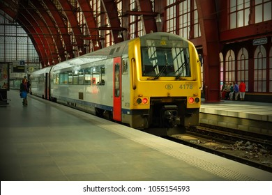Antwerp, Belgium - 3 June 2015 : A train arriving at platform of the Antwerpen-Central Railway Station, one of the most beautiful train stations in the world.