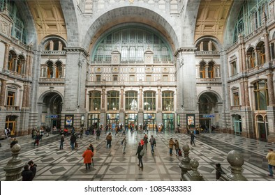 ANTWERP, BELGIUM - APR 2: Terminus of railway station Antwerpen Centraal, constructed in 1905 and crowd of rashing passengers on April 2, 2018. More than 1,200,000 people lives in Antwerp