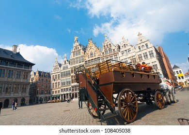 Antwerp, Belgium - April 14, 2010: Large traditional wooden horse-drawn carriage at Grote Markt transporting passengers around to famous tourist sights