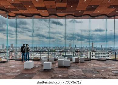 ANTWERP, BELGIUM - April 15, 2017: The MAS museum, Museum aan de Stroom, along the river Scheldt in Antwerp, Belgium, and its view on the skyline of the city of Antwerp.