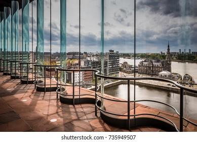 ANTWERP, BELGIUM - April 15, 2017: The MAS museum, Museum aan de Stroom, along the river Scheldt in Antwerp, Belgium, and its view on the skyline of the city of Antwerp.