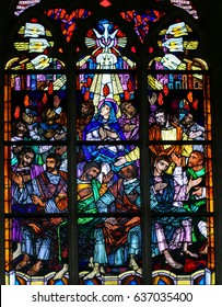 ANTWERP, BELGIUM - APRIL 30, 2017: Stained Glass window in the Church of Saint Andrew in Antwerp, Belgium, depicting Mary and the Apostles at Pentecost