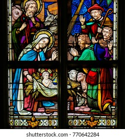 ANTWERP, BELGIUM - APRIL 30, 2017: Stained Glass in the Church of Saint Andrew in Antwerp, Belgium, depicting a Nativity Scene at Christmas