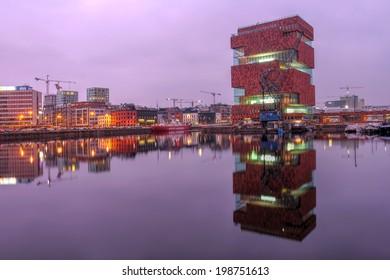 ANTWERP, BELGIUM - APRIL 4: Museum aan de Stroom (MAS) caught the purple glow of sunset in Antwerp, Beligum on April 4th, 2014. The museum is a recent addition to Antwerp's skyline, opening in 2011.