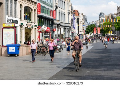 ANTWERP, BELGIUM - AUG 11: People and cyclists in the main shopping street of Antwerp downtown in the city on August 11, 2015 in Antwerp, Belgium