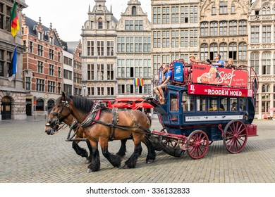 ANTWERP, BELGIUM - AUG 11: Tourists making a ride in a horsecar at a medieval square downtown in the city Antwerp on August 11, 2015 in Antwerp, Belgium