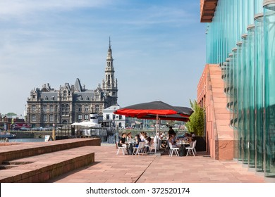 ANTWERP, BELGIUM - AUG 13: Terrace with unknown people near museum MAS on August 13, 2015 in the harbor of Antwerp, Belgium