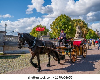 Antwerp, Belgium - August 25, 2018 : Traditional horse cart enjoyed by tourist at Market square in Antwerp