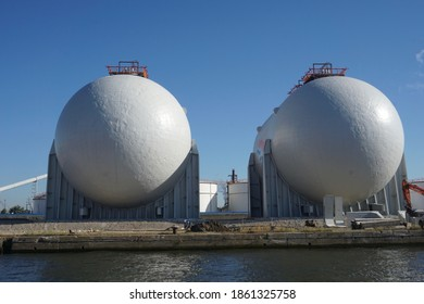 Antwerp, Belgium - August 6, 2018; Two large storage tanks on the bank in the port area of Antwerp
