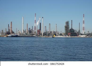 Antwerp, Belgium - August 6, 2018; Large harbor cranes on the banks of the port area of Antwerp
