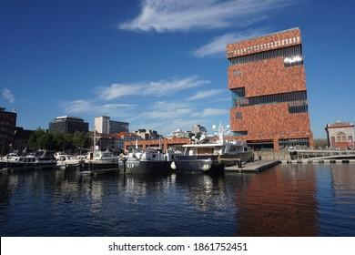 Antwerp, Belgium - August 6, 2018; The 'Museum Aan de Stroom' is located on the edge of the Willemdok marina