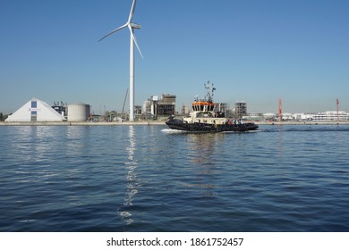 Antwerp, Belgium - August 6, 2018; A large tugboat sails in the port area of Antwerp
