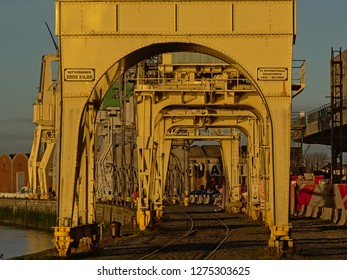 ANTWERP, BELGIUM, DECEMBER 11, 2018, Rail track under old industrial cranes belonging to the collection of the MAS museum, on a quay along river Scheldt in the harbor of Antwerp, 11 December 2018