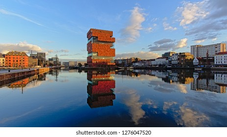 ANTWERP, BELGIUM, DECEMBER 11, 2018, Willemdok dock, with MAS museum and residential and office buildings reflecting in the water surface in warm evening light in Antwerp, 11 December 2018