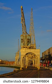 ANTWERP, BELGIUM, DECEMBER 11, 2018, Old industrial cranes belonging to the collection of the MAS museum, on a quay along river Scheldt in the harbor of Antwerp, 11 December 2018