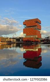 ANTWERP, BELGIUM, DECEMBER 11, 2018,  MAS museum, reflecting in the water of Willemdok dock in Antwerp, 11 December 2018