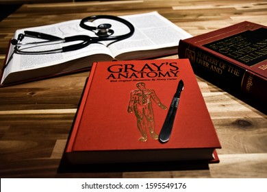 Antwerp, Belgium - December 22 2019, Gray's anatomy, the original book, with surgical books and a stethoscope on a doctor's desk