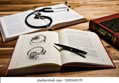 Antwerp, Belgium - December 22 2019, Anatomy book and surgical books with a stethoscope