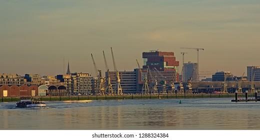 ANTWERP, BELGIUM, DECEMBER 26, 2018, skyline from across river Scheldt, with MAS museum, old industrial cranes and new residential skyscrapers. Antwerp, 26 December 2018