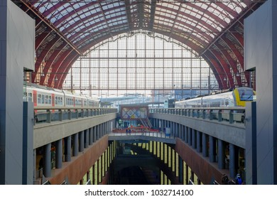 Antwerp, Belgium - February 21 2018: tourists and commuters travelling by train seen in the inside of the Antwerp Central railway station
