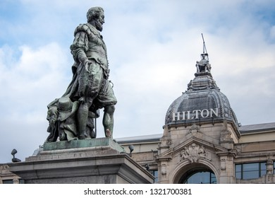 ANTWERP, BELGIUM - FEBRUARY 21, 2019: The statue of Pieter Paul Rubens in front of the Hilton Antwerp hotel at Groenplaats square.