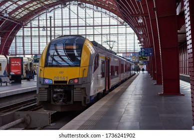 ANTWERP, BELGIUM - February 24, 2017: A train arriving at platform of the Antwerpen-Central Railway Station, one of the most beautiful train stations in the world.