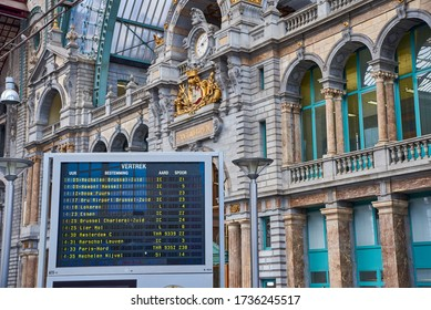 ANTWERP, BELGIUM - February 24, 2017: Interior of the famous Antwerp Central Train Station with digital board with departure and arrival times