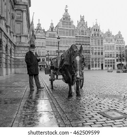 Antwerp, Belgium - January 16, 2016: Man with cart and horse on main square in Antwerp, Belgium. Antwerp is the capital of Antwerp province and the most populous city in Belgium.
