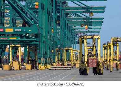 ANTWERP, BELGIUM - JUL 9, 2013: Mobile Container Spreaders at the MSC Home shipping terminal in the Port of Antwerp.