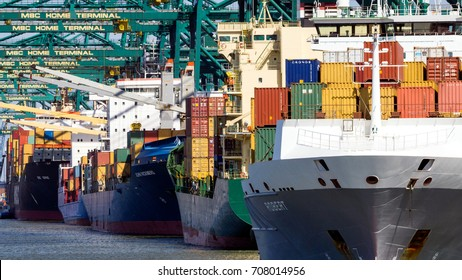 ANTWERP, BELGIUM - JUL 9, 2013: Container ships moored at the MSC Home container terminal in the Port of Antwerp.