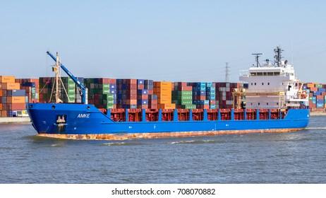 ANTWERP, BELGIUM - JUL 9, 2013: Container ship entering the Port of Antwerp.