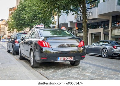 ANTWERP, BELGIUM. July 18, 2017. Black Peugeot taxi cab parked on the side of the street in central Antwerp.