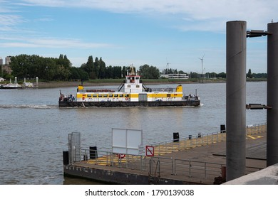 Antwerp, Belgium, July 19, 2020, ferry sails with tourists from left bank to right bank