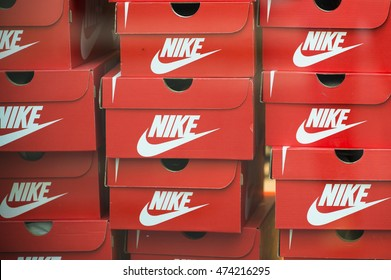 ANTWERP, BELGIUM - JULY 6, 2015: Boxes stacked shoes, Nike brand in a window of a shoe store.