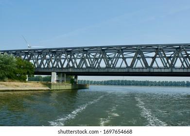 Antwerp, Belgium - July 6, 2018; The Noordland Bridge is a double bridge over the 'Schelde-Rijnkanaal'. One bridge for the railway and one for other traffic.