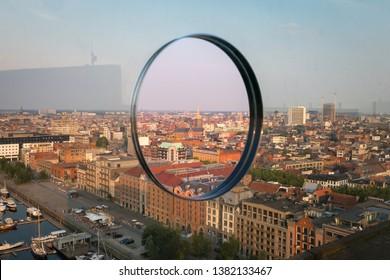 Antwerp, Belgium - June 10, 2018: Cityscape of the Belgian city of Antwerp seen through a hole in a glass