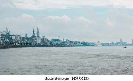 Antwerp, / Belgium - June 12 2019 A view of the skyline and landmarks of Antwerp. Harbour and port near the river Schelde