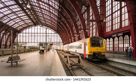 Antwerp, Belgium - June 24, 2018 : A train arriving at platform of the Antwerpen-Central Railway Station, one of the most beautiful train stations in the world.