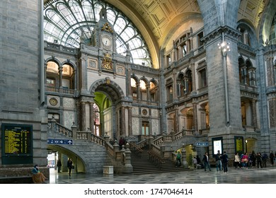 Antwerp, Belgium - June 3, 2015 :  Interior of Antwerp Central Station, one of the most beautiful train stations in the world, with passengers and tourists walking and sightseeing.
