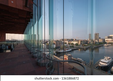 Antwerp, Belgium – June 9, 2018: The MAS museum, Museum aan de Stroom, along the river Scheldt in Antwerp, Belgium, and its view on the skyline of the city of Antwerp