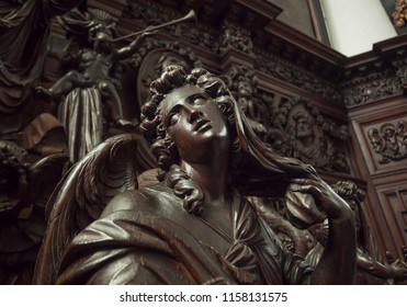 ANTWERP, BELGIUM - MAR 30: Angel with emotional expression or reflections, wooden statue in 12th century Saint Michael's church on March 30 2018. Near 1,200,000 people lives in Antwerp