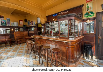 ANTWERP, BELGIUM - MAR 30: Bar counter and vintage wooden furniture inside empty cafe in old style on March 30, 2018. More than 1,200,000 people lives in Antwerp