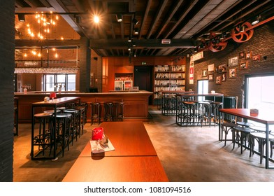 ANTWERP, BELGIUM - MAR 30: Bar counter and wooden tables inside the historical brewery making local beer with trademark De Koninck on March 30, 2018. More than 1,200,000 people lives in Antwerp