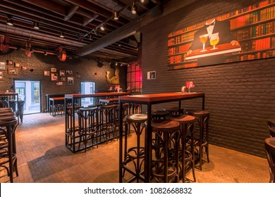 ANTWERP, BELGIUM - MAR 30: Bar stool and empty tables for beer party inside historical brewery with trademark De Koninck on March 30, 2018. More than 1,200,000 people lives in Antwerp