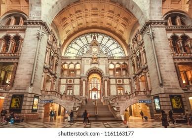 ANTWERP, BELGIUM - MAR 30: Built in 1905, beautiful terminus of railway station Antwerpen Centraal, with busy passengers on March 30, 2018. Near 1,200,000 people lives in Antwerp