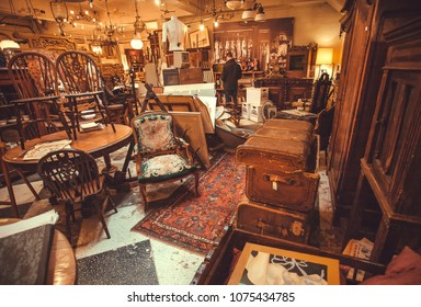 ANTWERP, BELGIUM - MAR 30: Buyers inside the antique shop with utensils, lamps, souvenirs and retro furniture on March 30, 2018. More than 1,200,000 people lives in Antwerp
